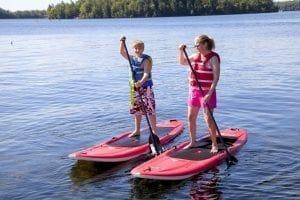 Photo of Two Children Paddleboarding. Escape Toronto This Summer en Route to Severn!