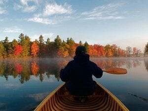 Photo of a Man Paddling on Gloucester Pool, One of the Best Fall Getaways in Ontario.