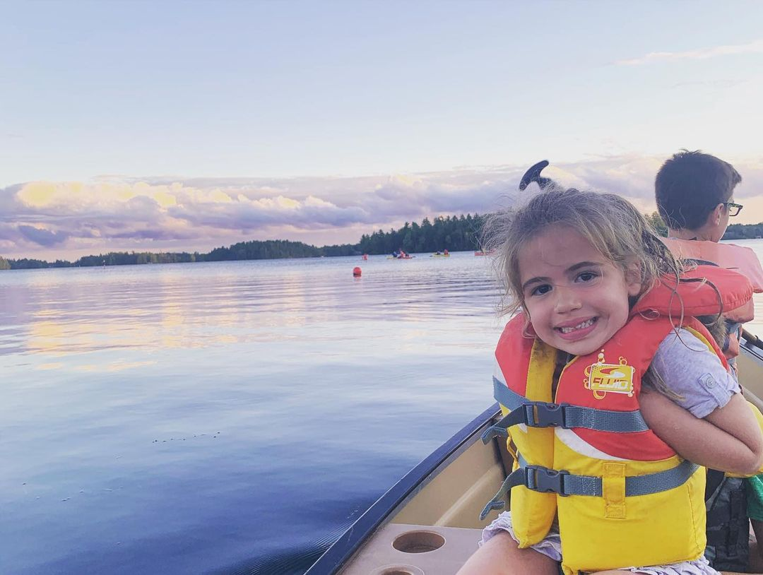 Photo of a Young, Happy Girl on a Canoe at Severn, One of the Best Ontario Getaways in Spring.